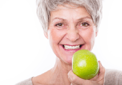 Older woman with an apple