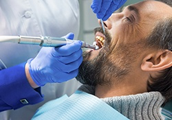 Older man receiving dental treatment