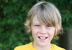 Preteen boy with healthy smile